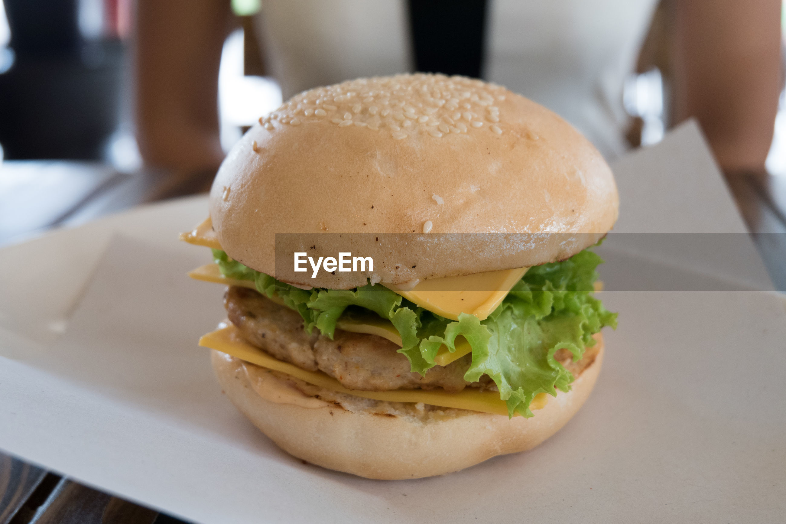 High angle view of burger served on table
