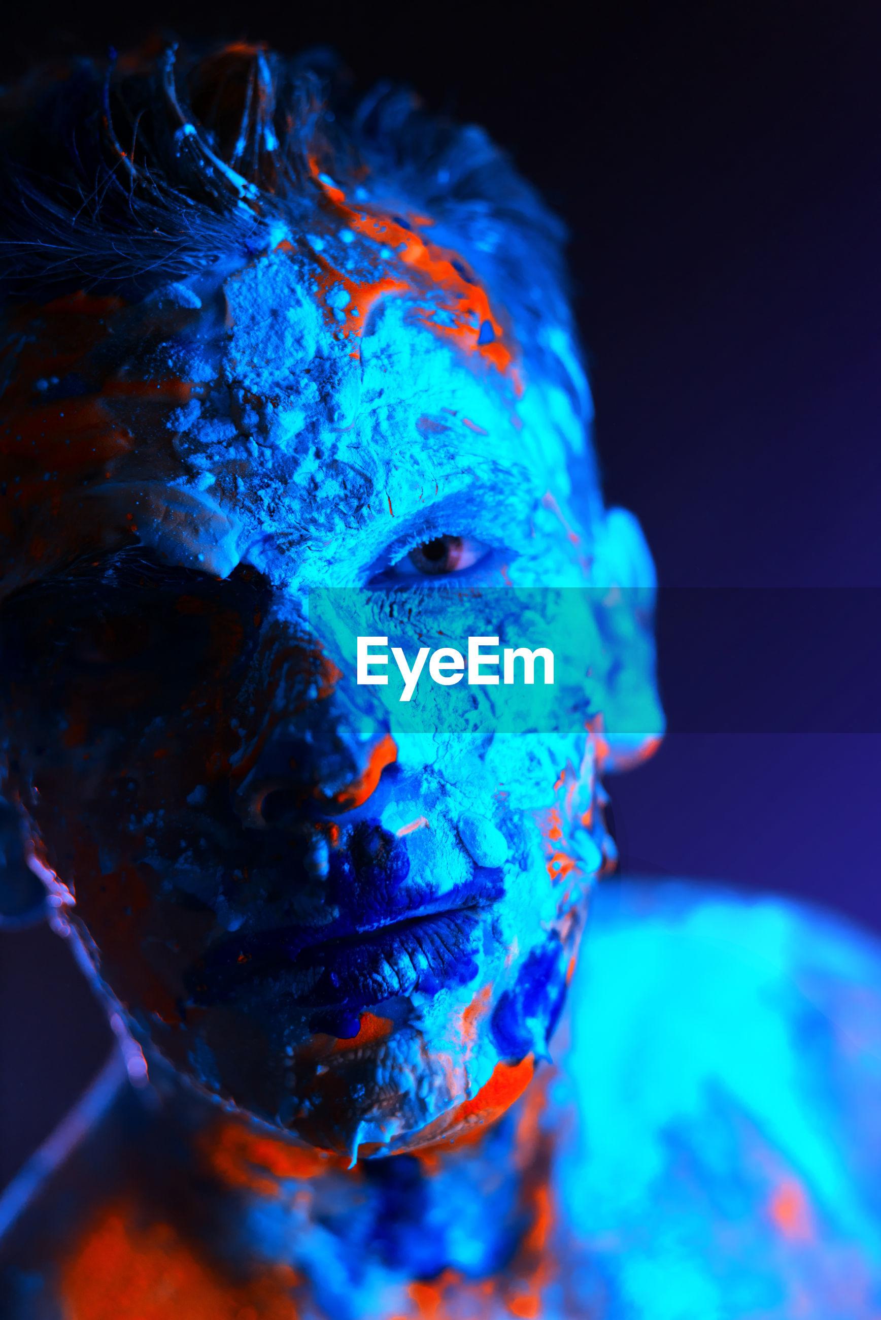 Portrait of man with face paint