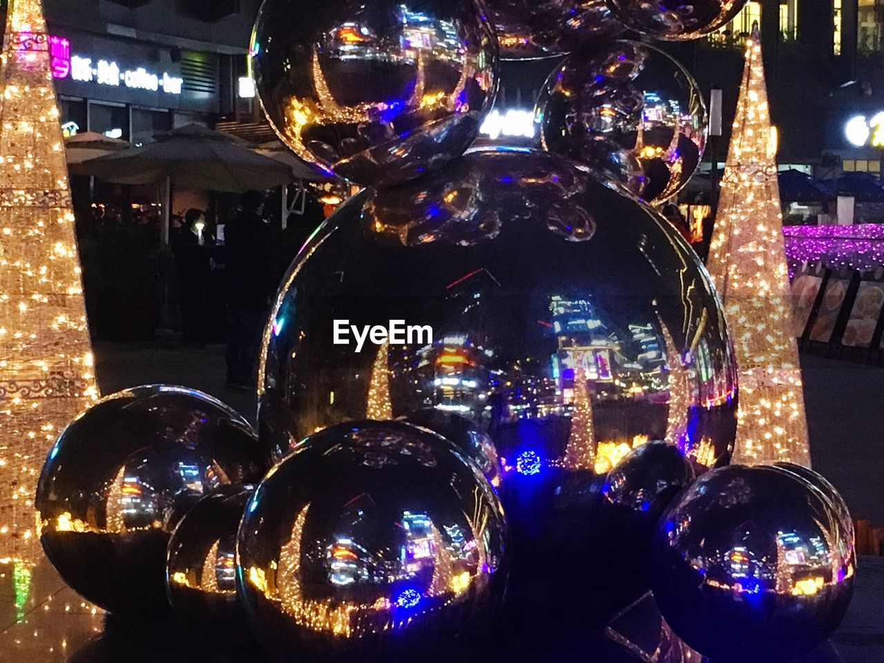 illuminated, night, decoration, reflection, christmas, christmas decoration, sphere, transparent, glass - material, no people, built structure, celebration, close-up, architecture, indoors, christmas ornament, shiny, holiday, focus on foreground, glass, silver colored, nightlife