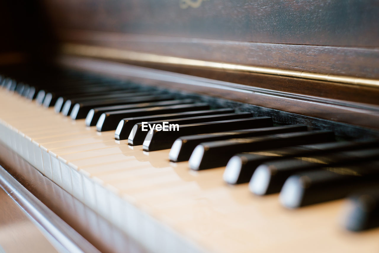music, musical instrument, musical equipment, piano, arts culture and entertainment, piano key, selective focus, indoors, close-up, no people, in a row, keyboard instrument, white color, keyboard, wood - material, still life, black color, high angle view, old