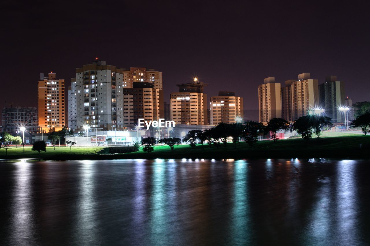 architecture, building exterior, built structure, night, illuminated, city, water, reflection, sky, building, waterfront, office building exterior, nature, urban skyline, skyscraper, no people, cityscape, outdoors, travel destinations