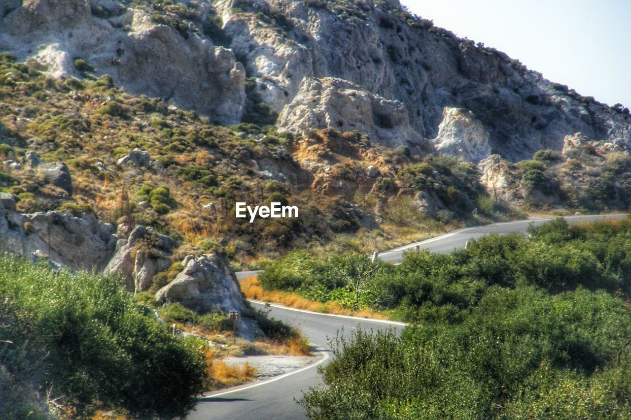 mountain, nature, curve, road, winding road, no people, day, outdoors, mountain road, scenics, water, tree, beauty in nature, sky