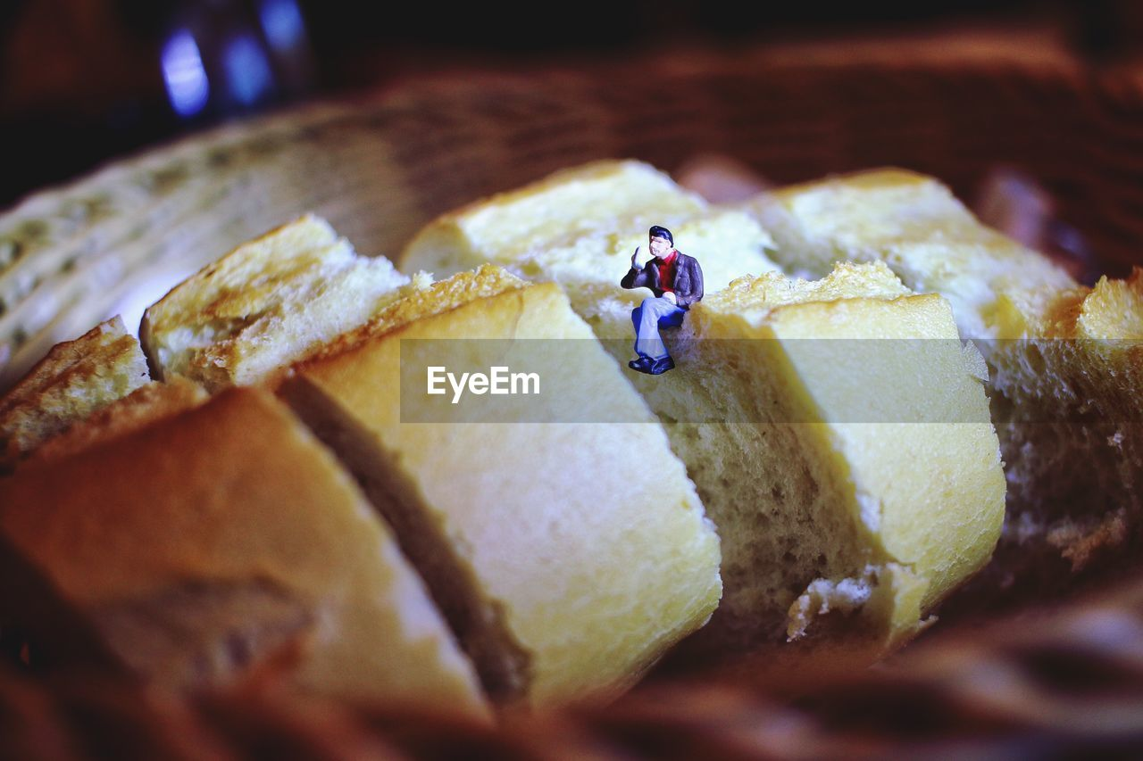 Close-up of figurine on bread