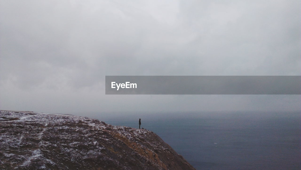 Scenic view of sea against sky in foggy weather during winter
