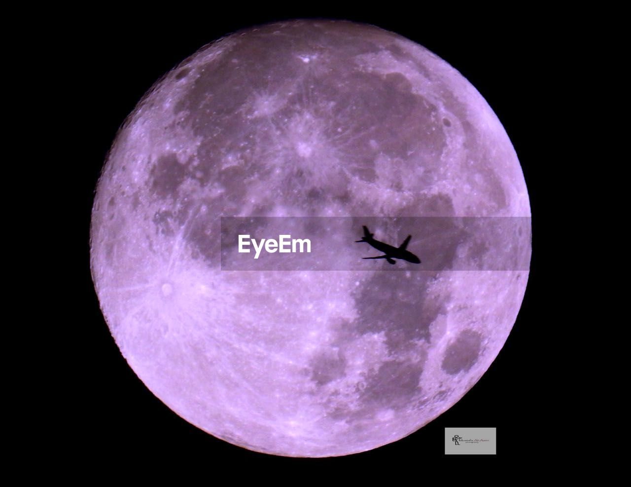 sky, night, moon, astronomy, space, flying, nature, no people, airplane, geometric shape, purple, air vehicle, beauty in nature, circle, low angle view, outdoors, full moon, mid-air, silhouette, animal themes, planetary moon