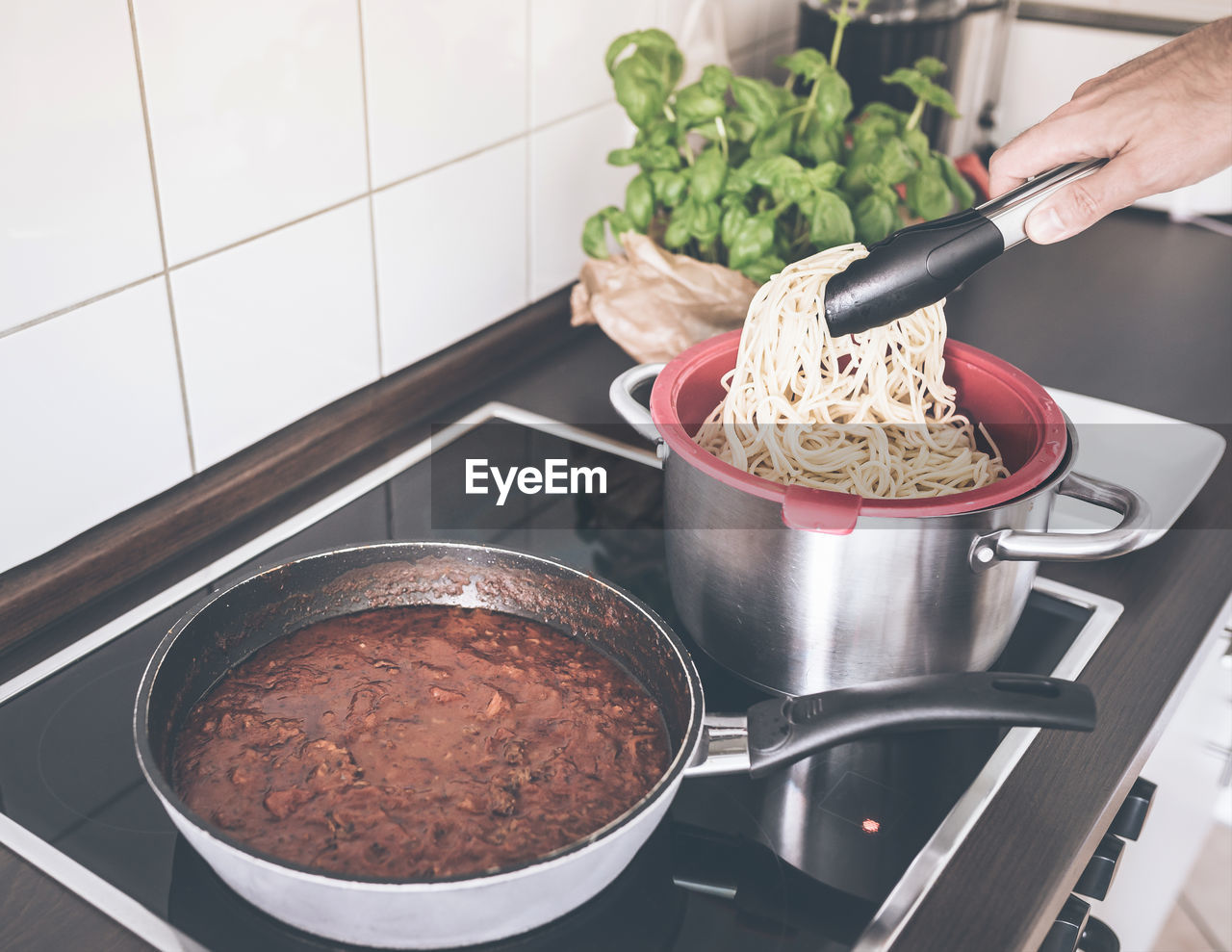 Cropped hand of man preparing food in kitchen at home