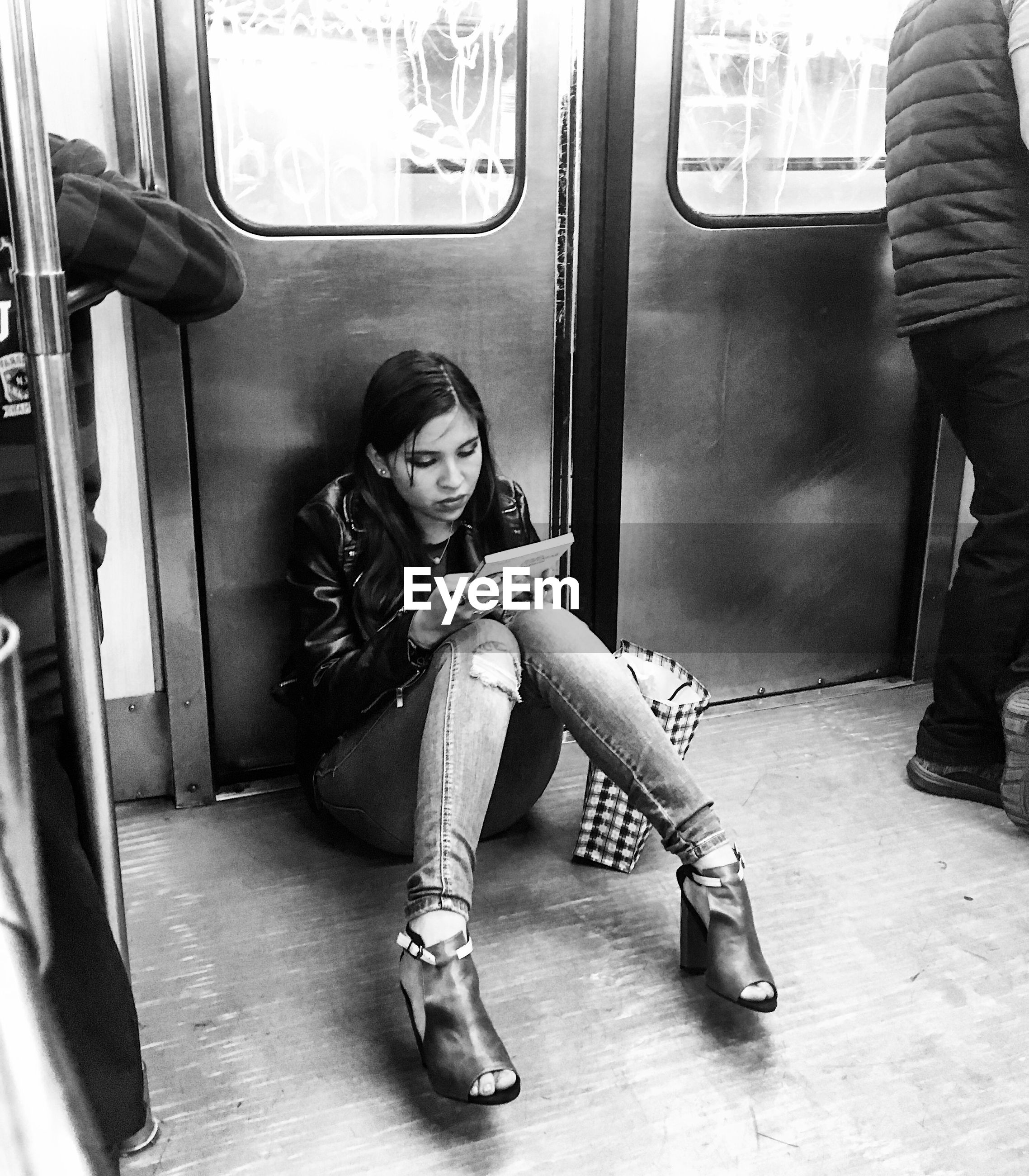 window, sitting, subway train, women, transportation, public transportation, adult, lifestyles, train - vehicle, adults only, mode of transport, beauty, one person, people, young women, one woman only, human body part, commuter, indoors, train interior, only women, beautiful woman, young adult, day