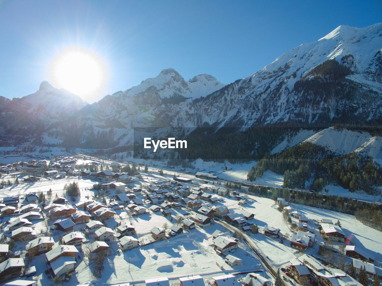 High angle view of houses by snowcapped mountains at kandersteg