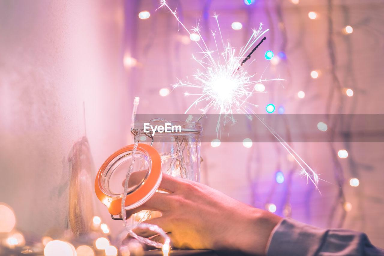 Close-Up Of Hand Holding Illuminated Sparkler