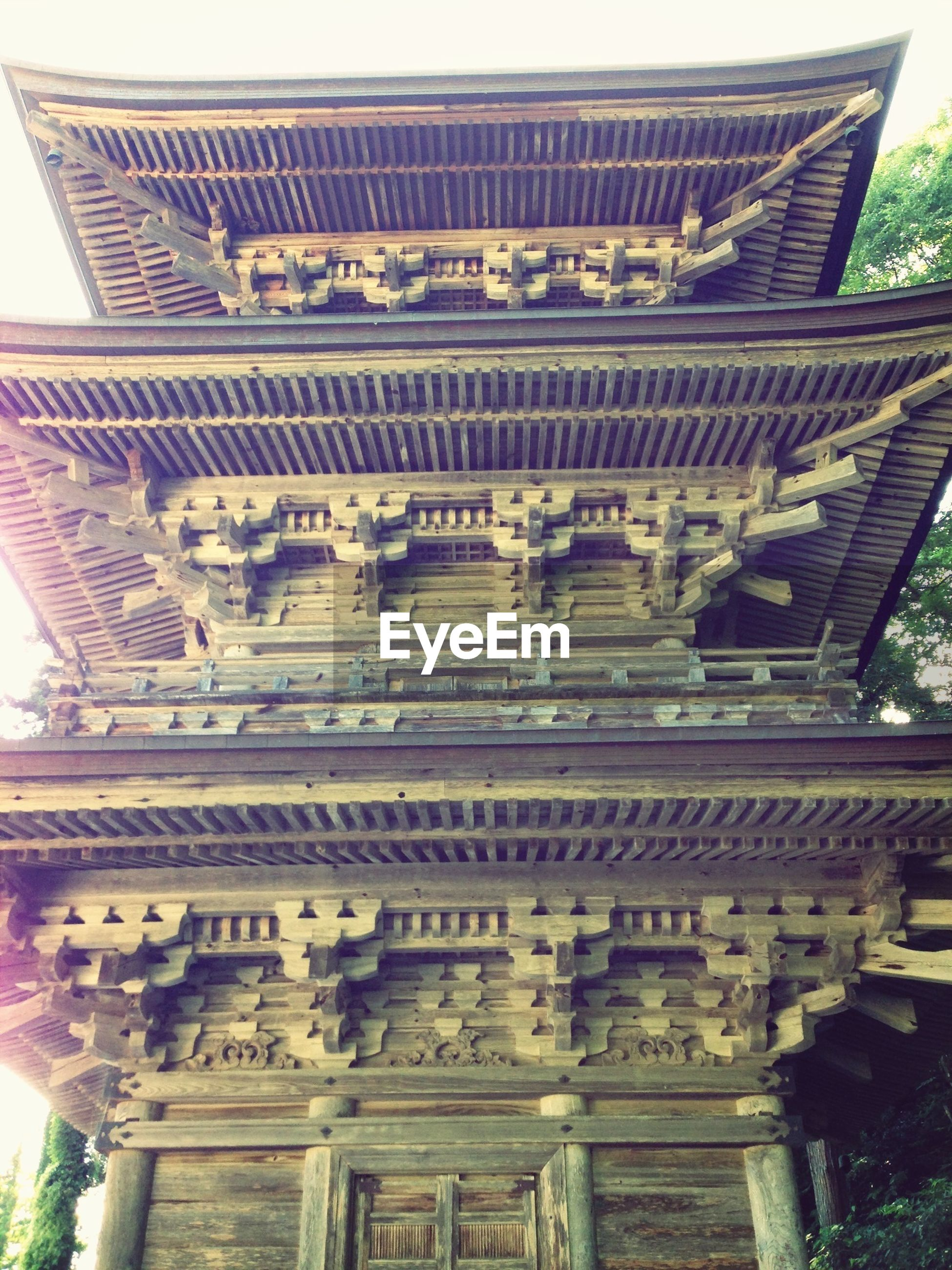 architecture, built structure, building exterior, low angle view, place of worship, religion, history, ornate, famous place, spirituality, temple - building, art and craft, travel destinations, architectural column, art, architectural feature, carving - craft product, day, tourism
