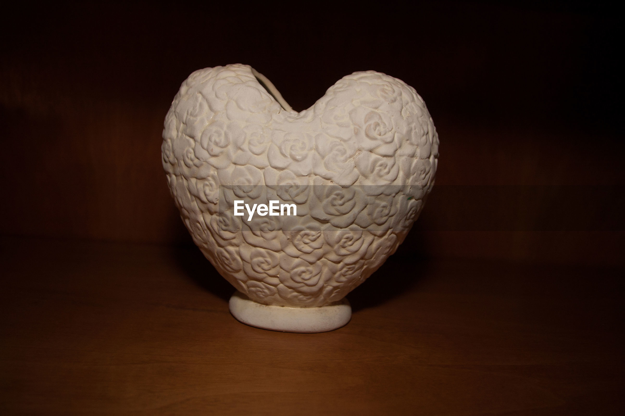 CLOSE-UP OF HEART SHAPE TABLE