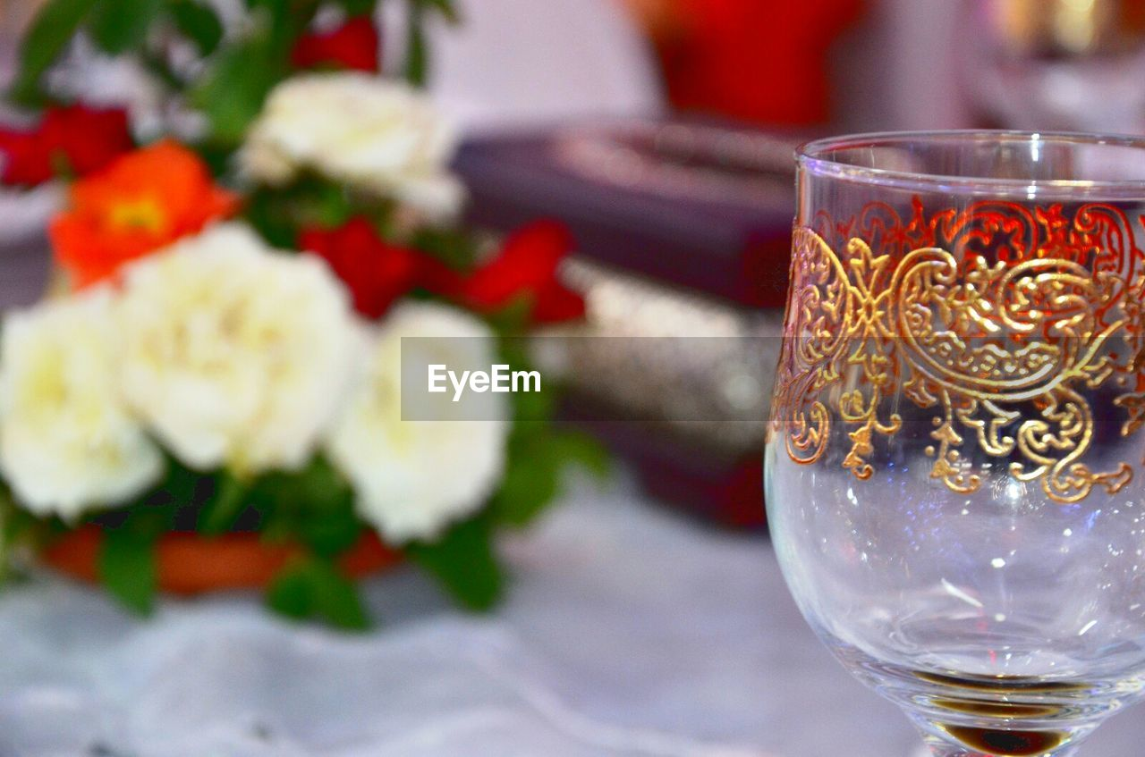 drink, food and drink, refreshment, drinking glass, alcohol, freshness, indoors, focus on foreground, table, no people, close-up, wineglass, champagne flute, wine, food, flower, healthy eating, day, ready-to-eat