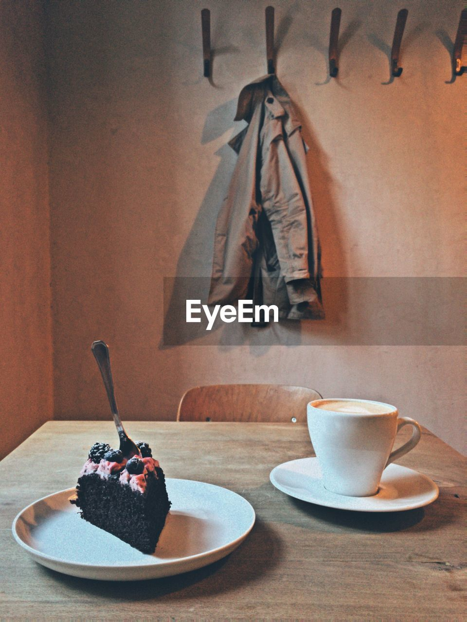 Close-up of fresh coffee and cake on table at home