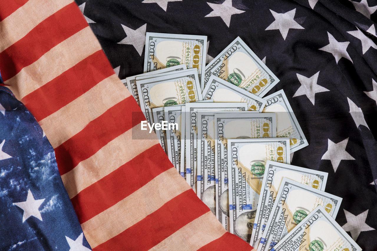 currency, paper currency, business, finance, wealth, indoors, flag, star shape, no people, shape, close-up, striped, patriotism, debt, full frame