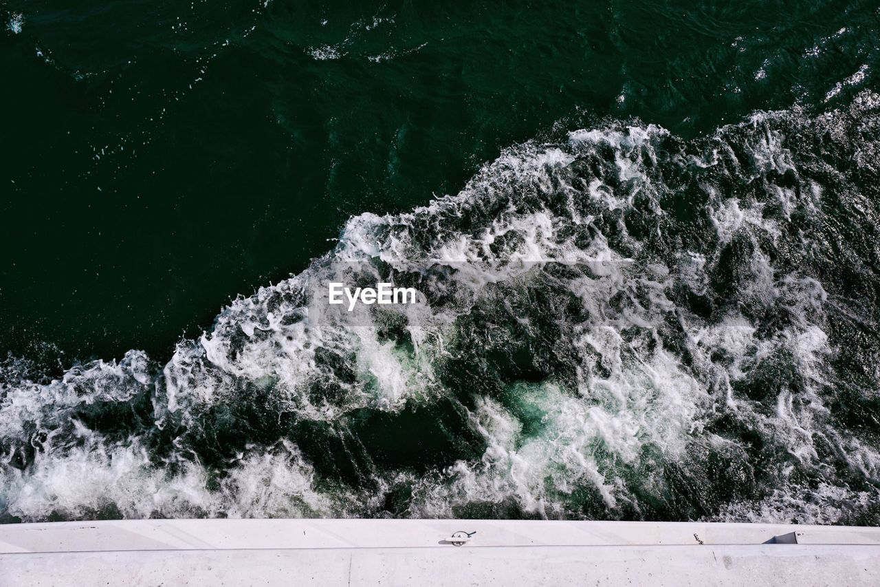 motion, water, sea, nature, no people, sport, day, outdoors, beauty in nature, wave, splashing, aquatic sport, blurred motion, high angle view, transportation, nautical vessel, close-up, scenics - nature, power in nature, flowing water