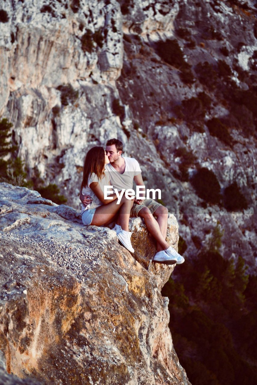 Young Woman Kissing On Cliff