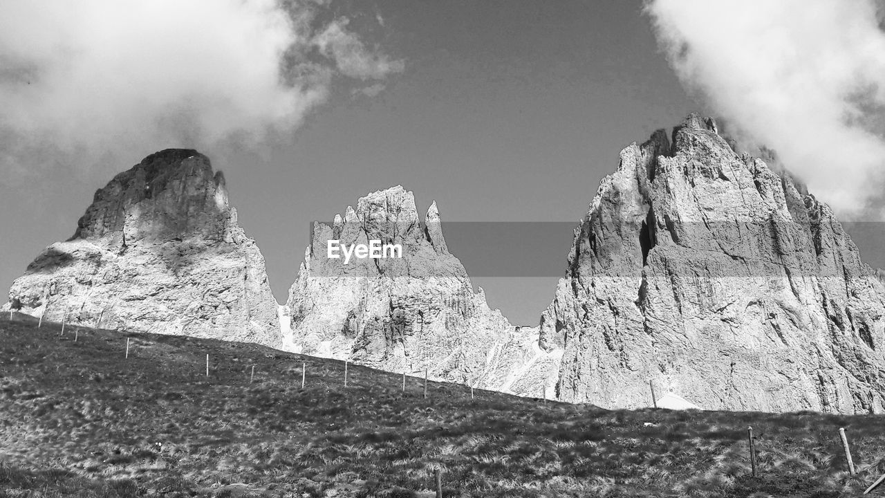 mountain, beauty in nature, scenics - nature, sky, day, tranquil scene, tranquility, rock, no people, non-urban scene, nature, environment, geology, physical geography, low angle view, landscape, mountain range, mountain peak, rock formation, outdoors, formation, eroded
