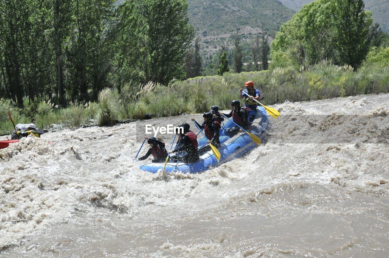People rafting on river