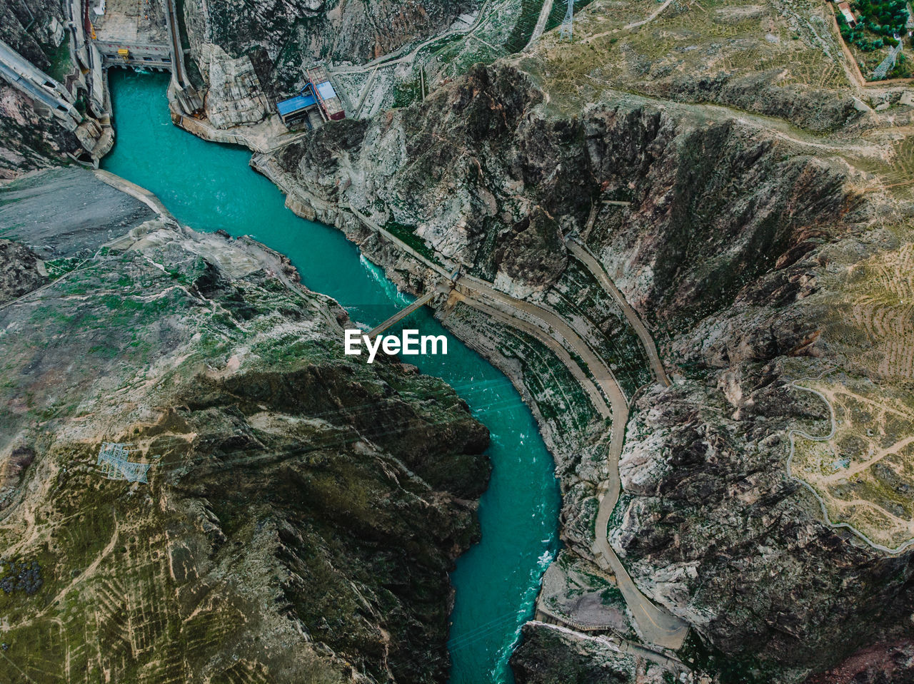 High Angle View Of River Amidst Rocky Mountain