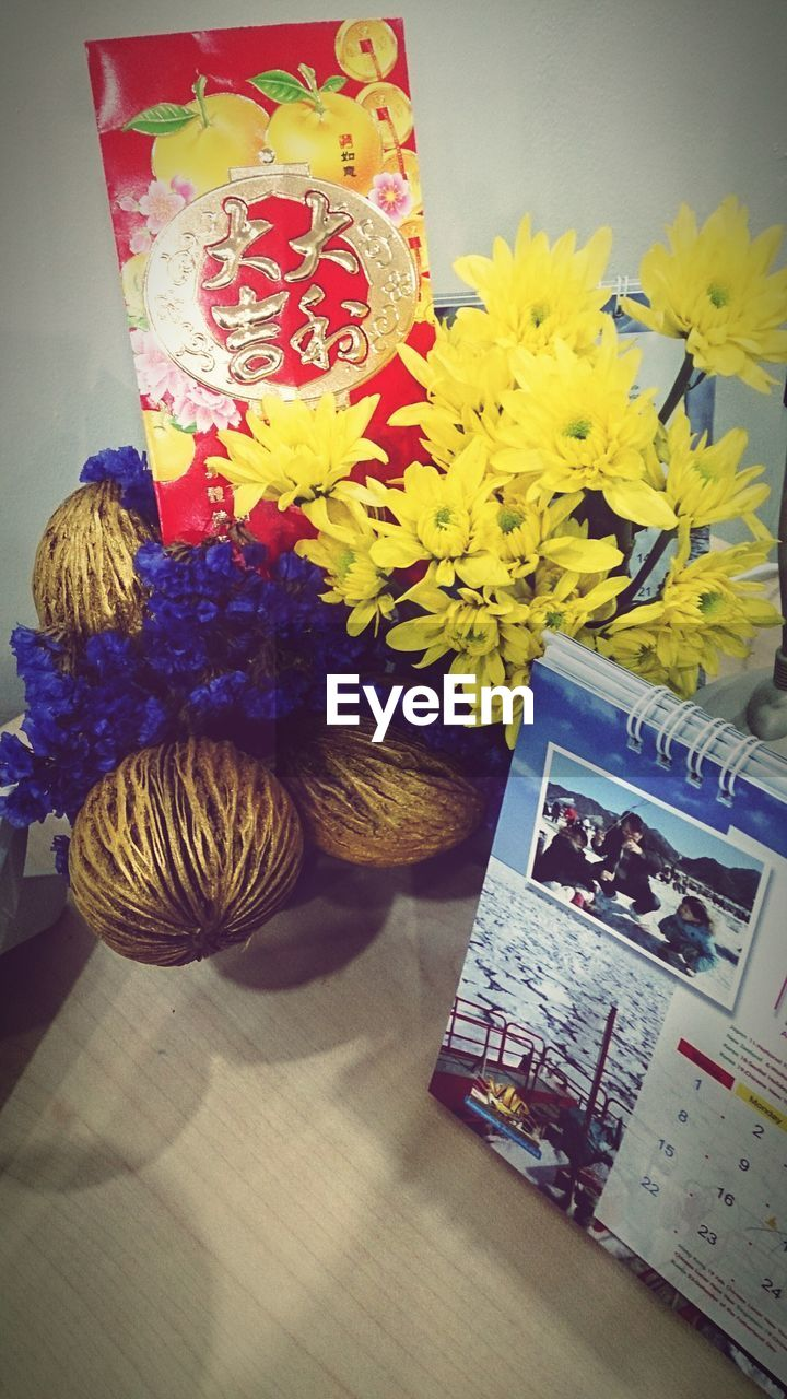 indoors, flower, table, vase, technology, book, no people, arrangement, close-up, day