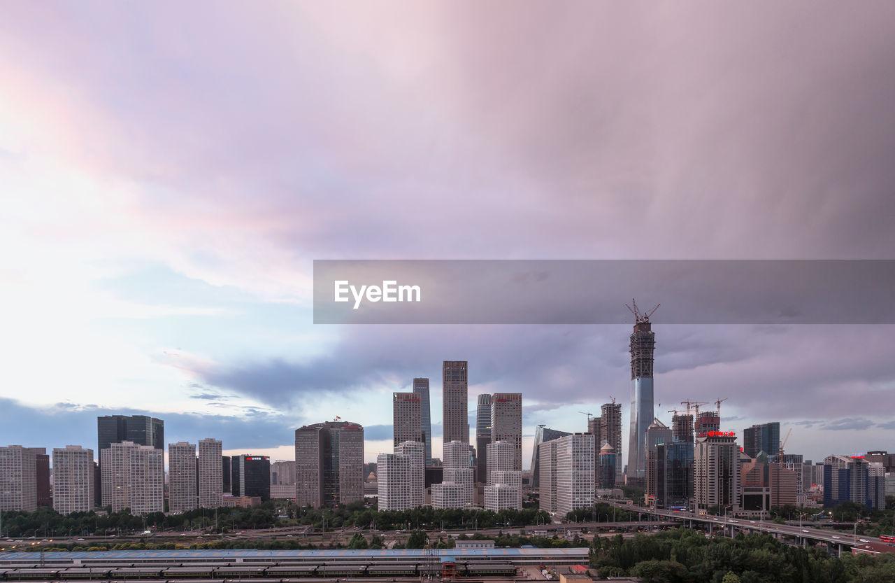 VIEW OF MODERN BUILDINGS IN CITY AGAINST SKY