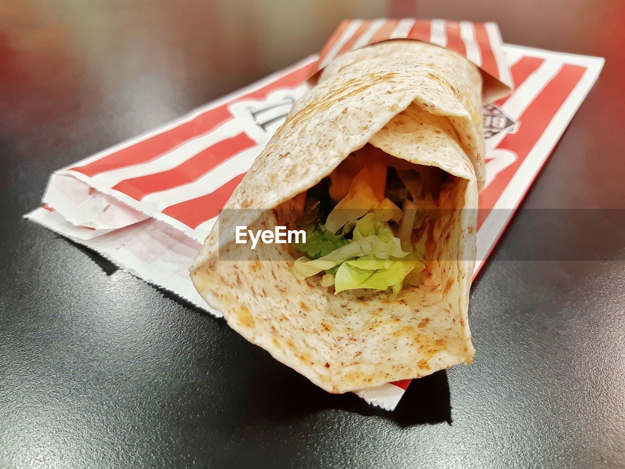 food, food and drink, ready-to-eat, sandwich, close-up, bread, freshness, still life, indoors, focus on foreground, table, no people, flag, healthy eating, wrap sandwich, paper, mexican food, tortilla - flatbread, snack, burrito