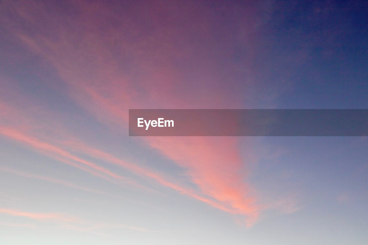 sky, cloud - sky, beauty in nature, low angle view, scenics - nature, tranquility, sunset, tranquil scene, no people, nature, backgrounds, idyllic, orange color, vapor trail, outdoors, full frame, meteorology, pink color, blue, day, romantic sky