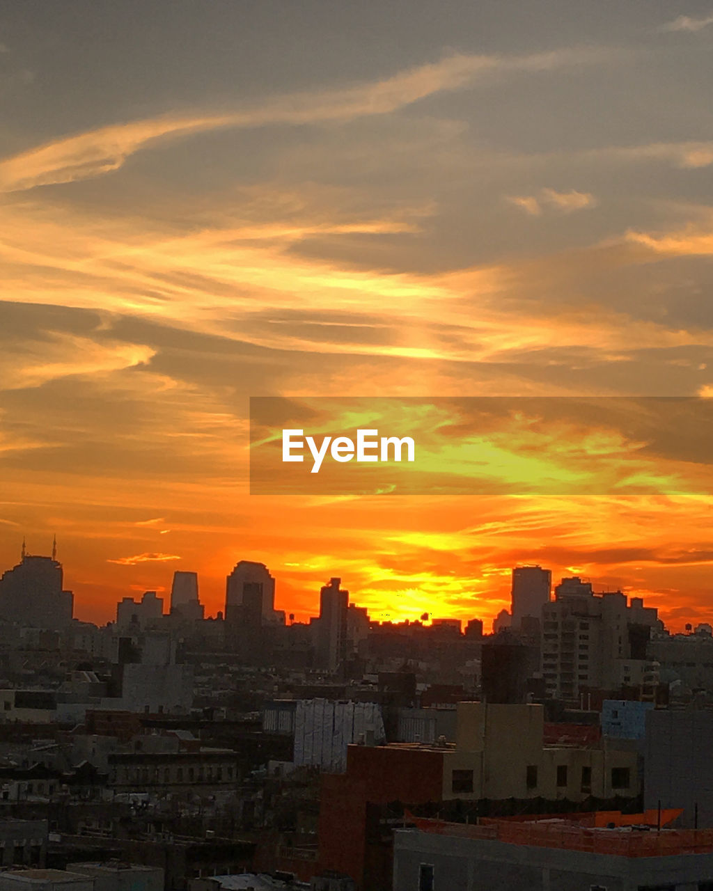 architecture, sunset, building exterior, built structure, cityscape, city, skyscraper, orange color, sky, urban skyline, travel destinations, no people, cloud - sky, outdoors, day