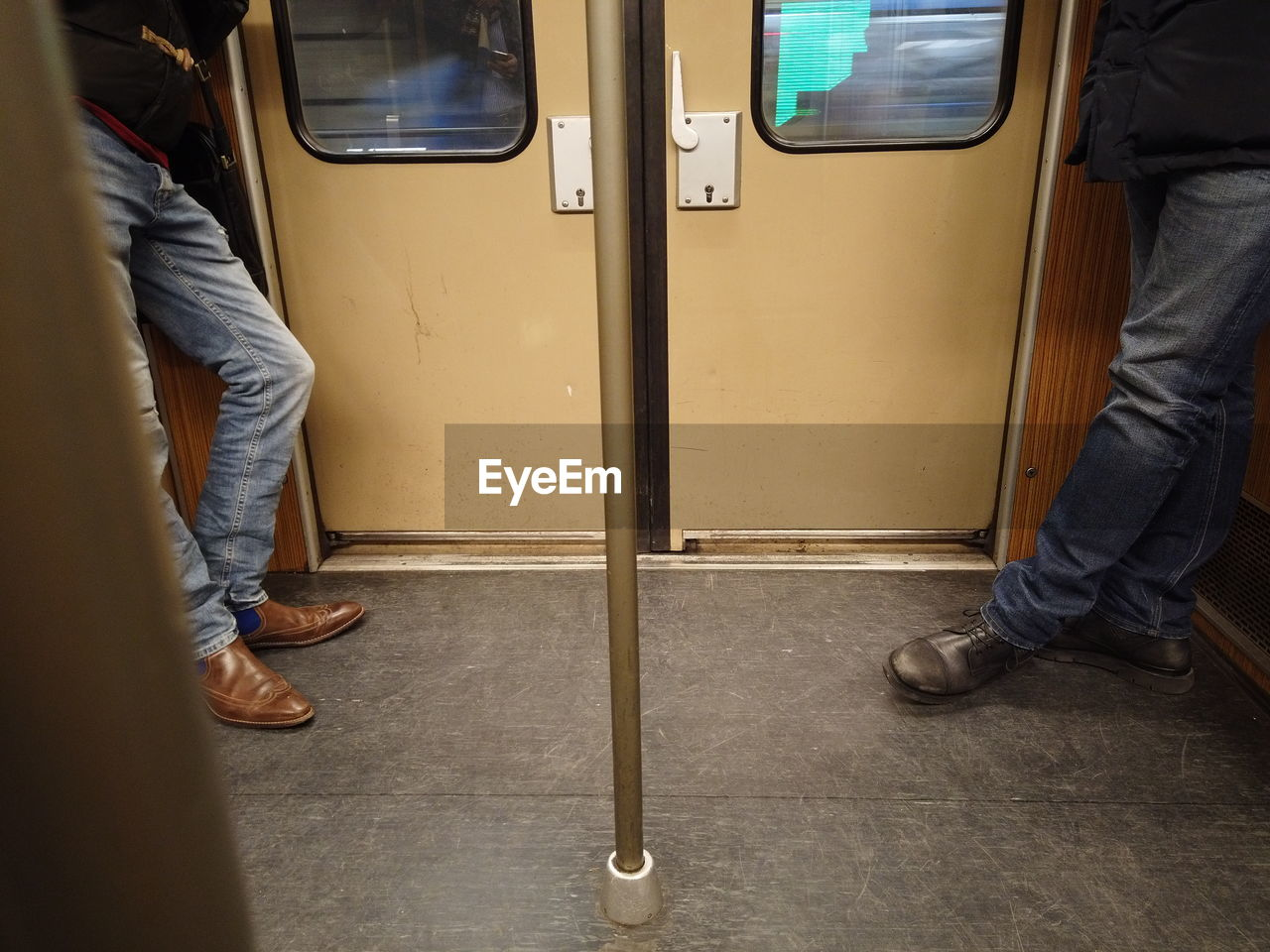 Low section of people in metro train