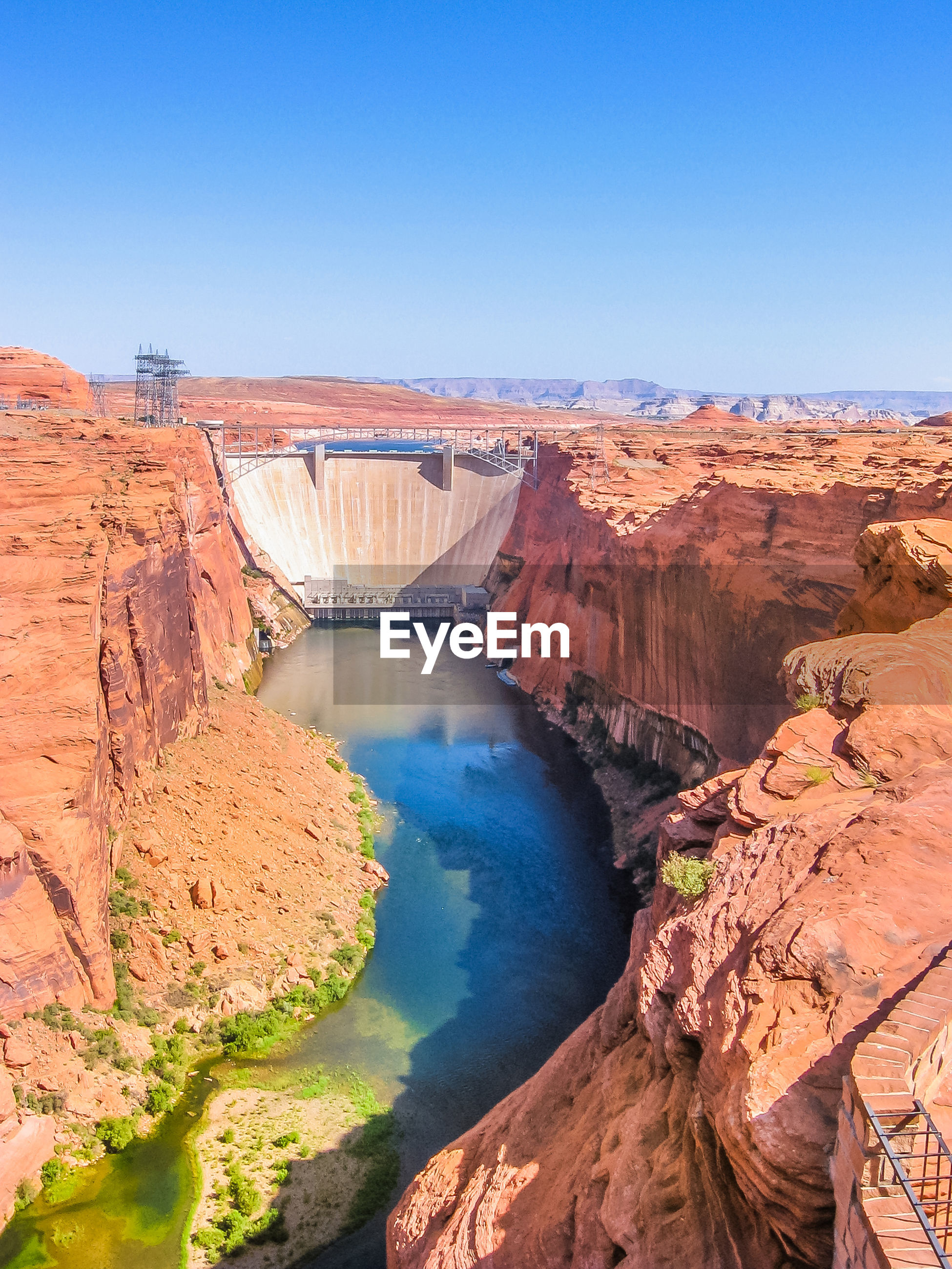 High angle view of dam against clear blue sky