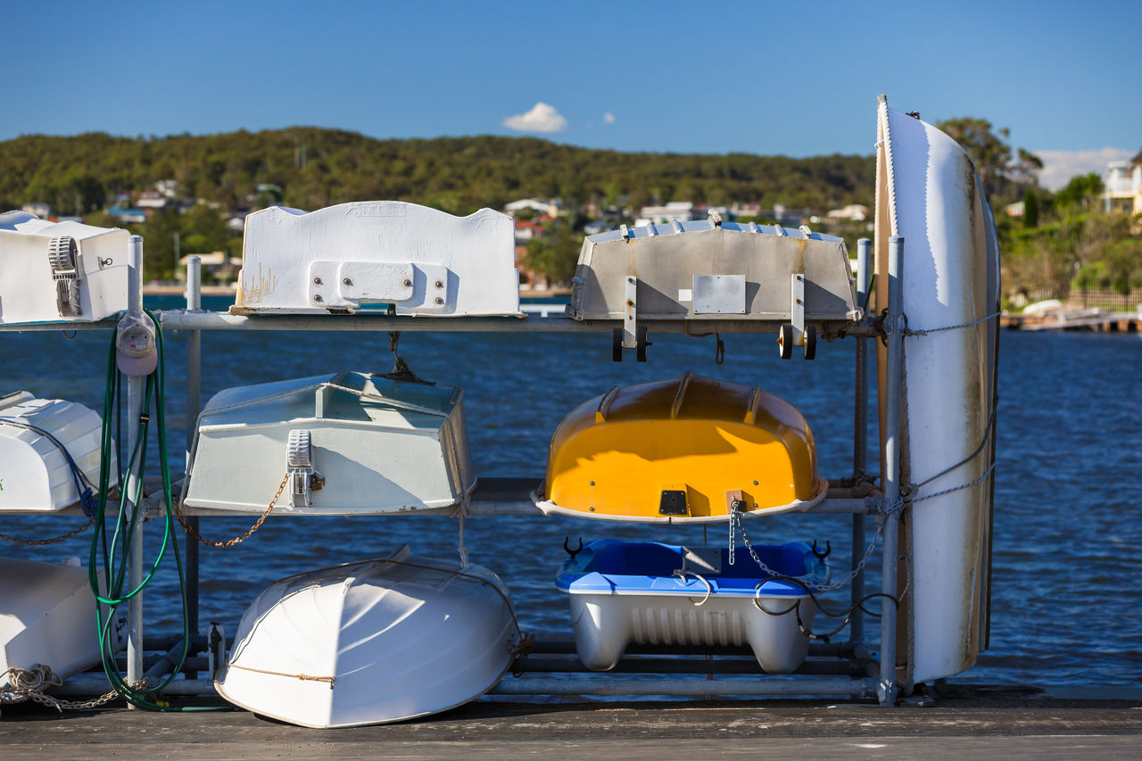 water, nature, day, no people, nautical vessel, sunlight, blue, sky, sea, mode of transportation, outdoors, transportation, land, architecture, sunny, building exterior, white color, built structure
