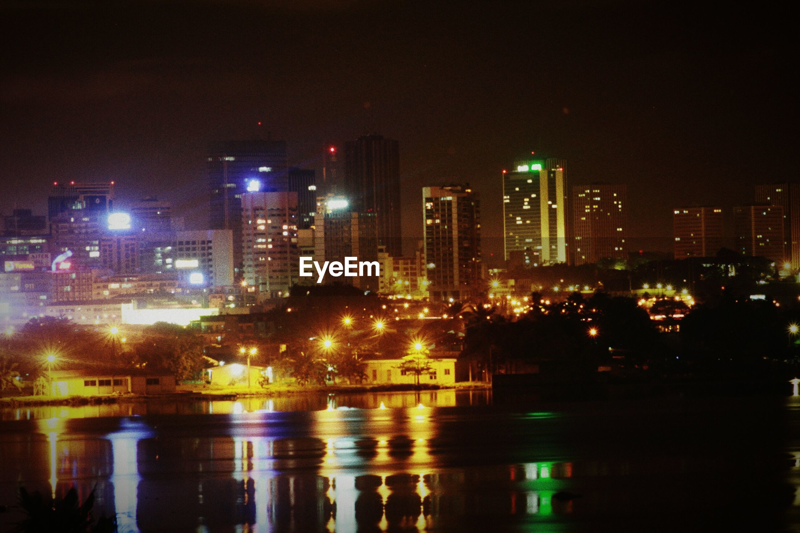 illuminated, night, city, building exterior, architecture, cityscape, skyscraper, built structure, water, urban skyline, modern, reflection, office building, tall - high, tower, river, financial district, waterfront, city life, sky
