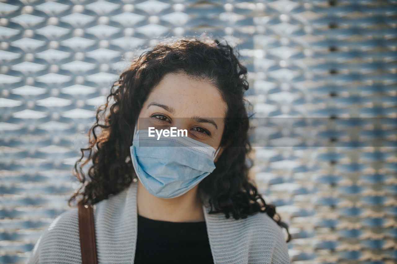 Portrait of a beautiful young woman with mask