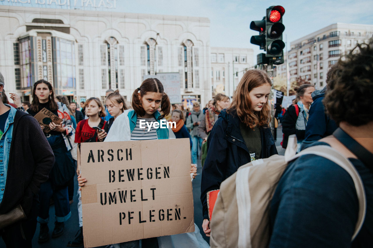 group of people, real people, architecture, building exterior, city, built structure, crowd, men, communication, day, text, adult, casual clothing, women, lifestyles, protestor, large group of people, protest, leisure activity, democracy