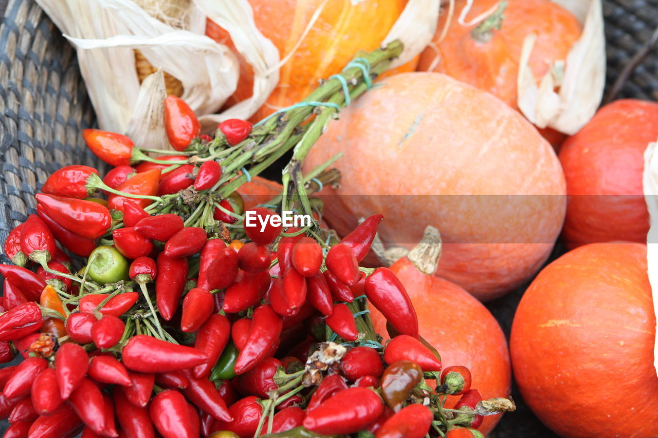 High Angle View Of Pumpkins And Red Chili Peppers At Market