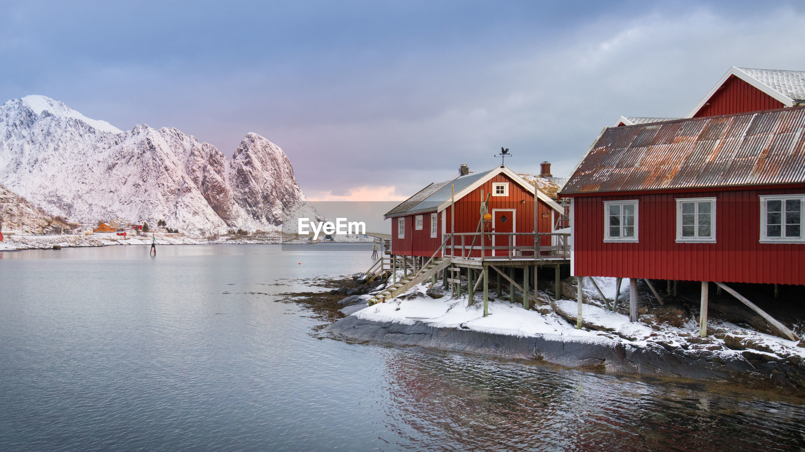 HOUSE BY BUILDING DURING WINTER