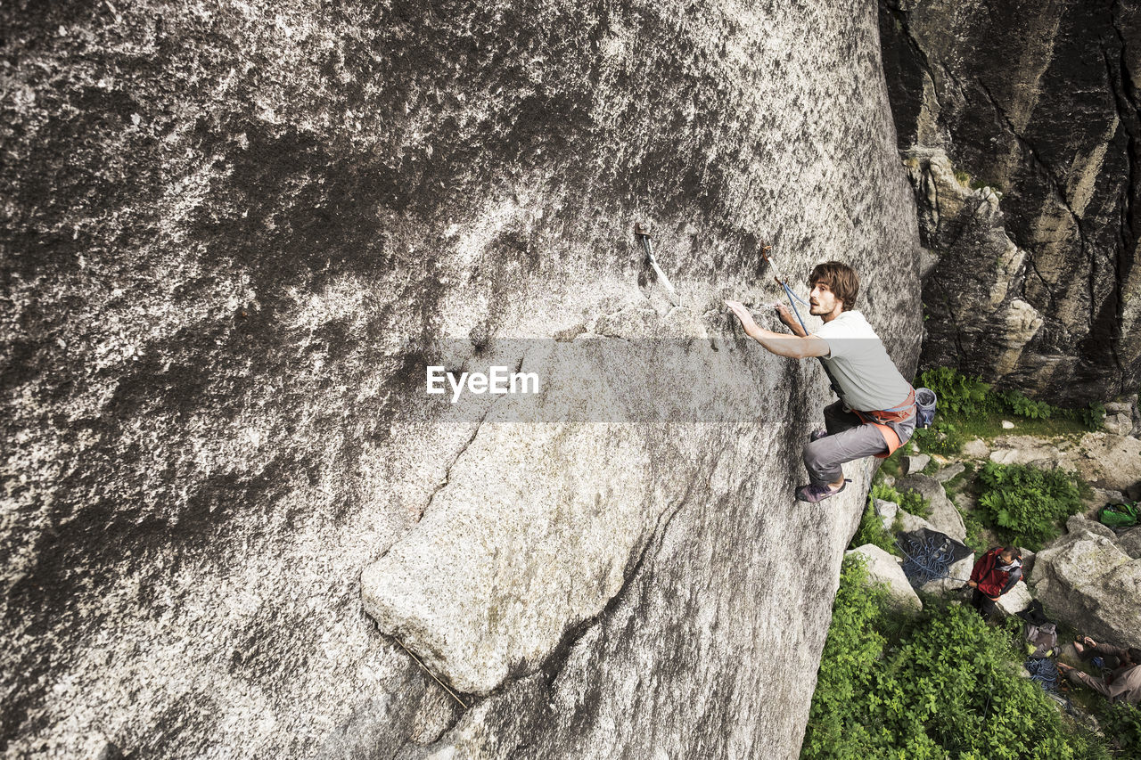 High angle view of man rock climbing