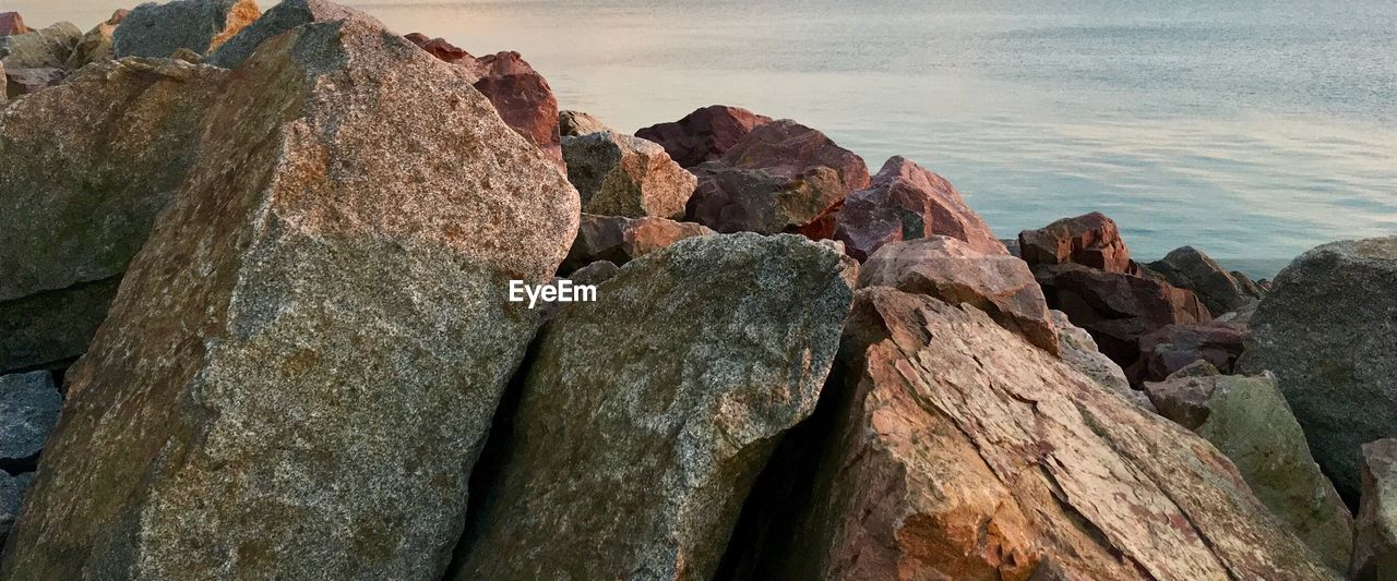 rock, solid, rock - object, sea, beauty in nature, nature, tranquility, water, no people, beach, land, scenics - nature, rock formation, tranquil scene, sky, day, outdoors, rough, textured, eroded