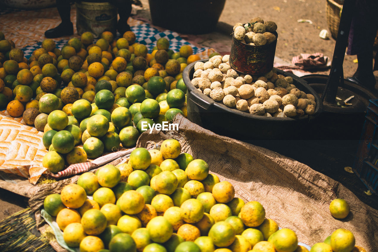 food, food and drink, fruit, healthy eating, market, freshness, retail, market stall, for sale, abundance, choice, large group of objects, wellbeing, variation, citrus fruit, day, no people, small business, container, business, outdoors, retail display, street market, ripe