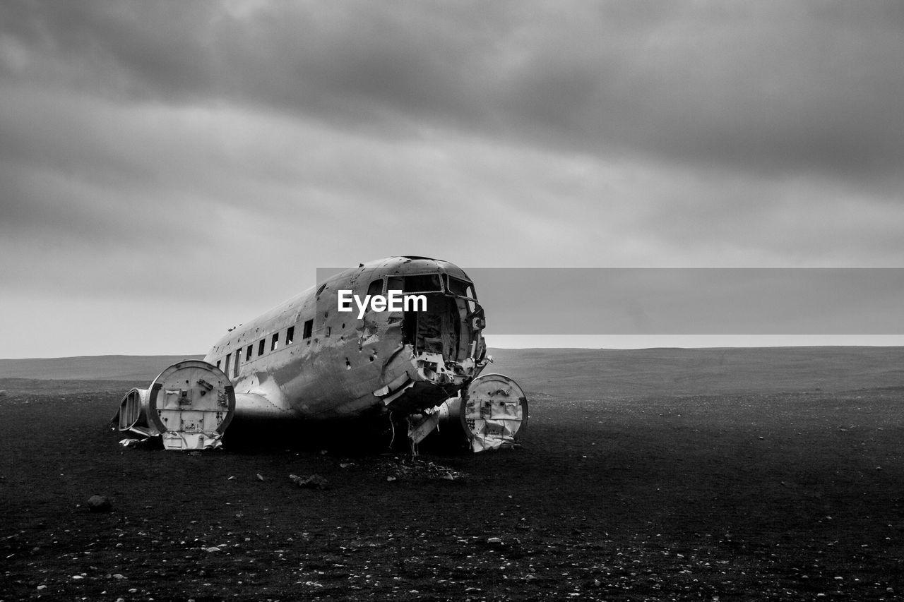 Airplane Wreckage At Solheimasandur Beach Against Cloudy Sky