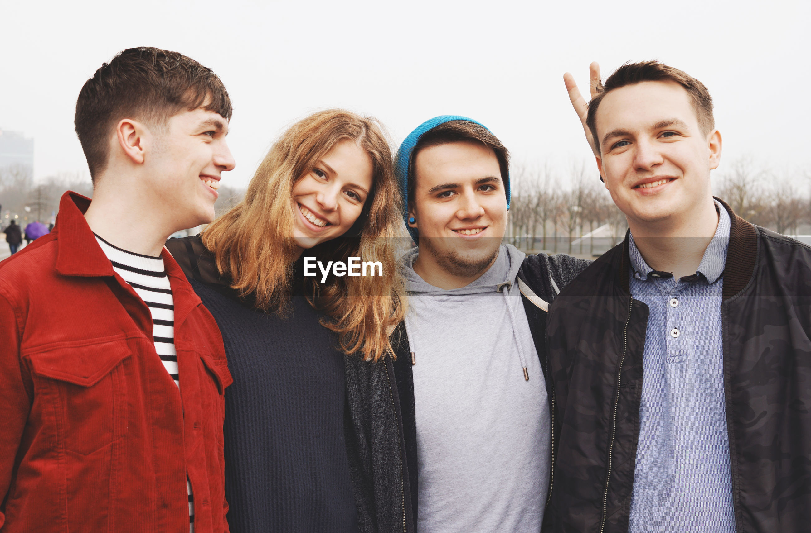 Portrait of friends with man in city