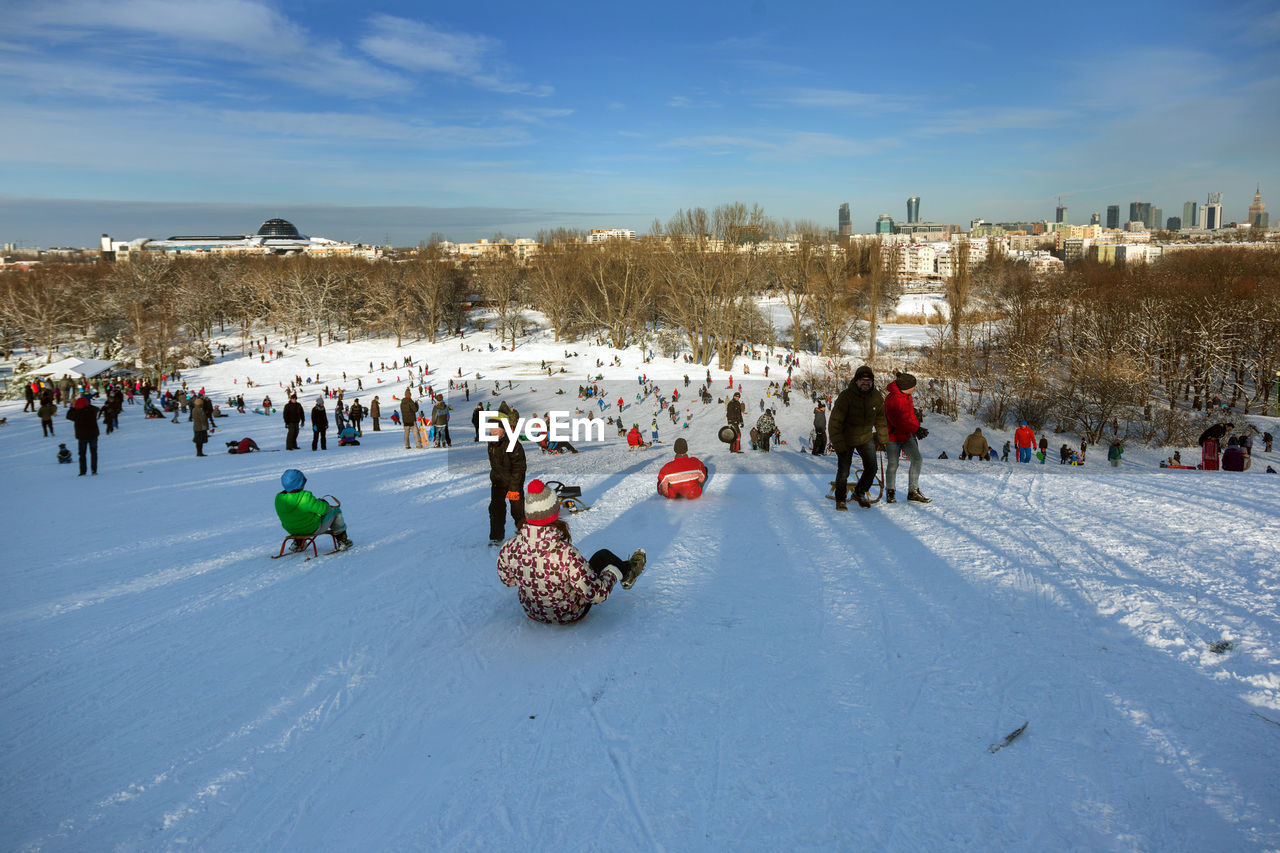 High Angle View Of People At Snow Covered Landscape Against Sky