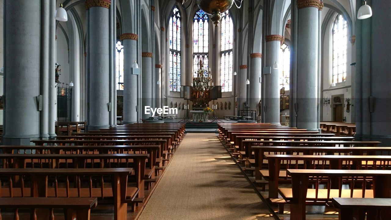 indoors, religion, place of worship, architectural column, spirituality, pew, architecture, no people, day