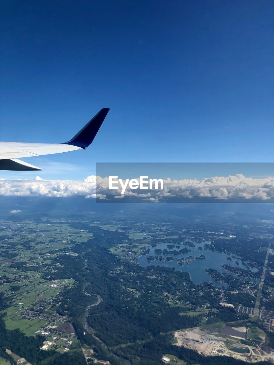 air vehicle, airplane, sky, flying, transportation, mode of transportation, aircraft wing, mid-air, nature, aerial view, landscape, beauty in nature, travel, day, environment, no people, blue, scenics - nature, outdoors, sunlight