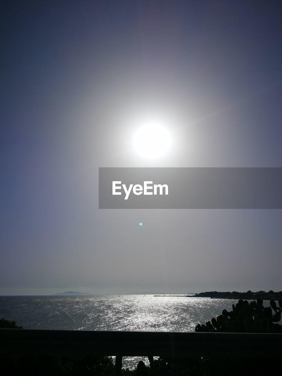sky, water, sea, beauty in nature, scenics - nature, horizon over water, sun, tranquility, tranquil scene, nature, horizon, sunlight, no people, idyllic, non-urban scene, outdoors, moon, clear sky, bright, moonlight