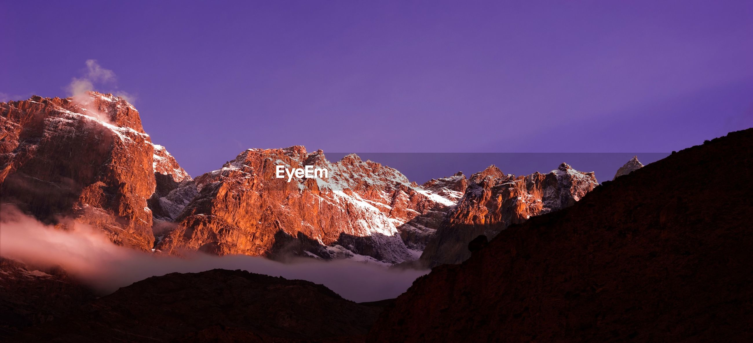 PANORAMIC SHOT OF MOUNTAINS AGAINST BLUE SKY