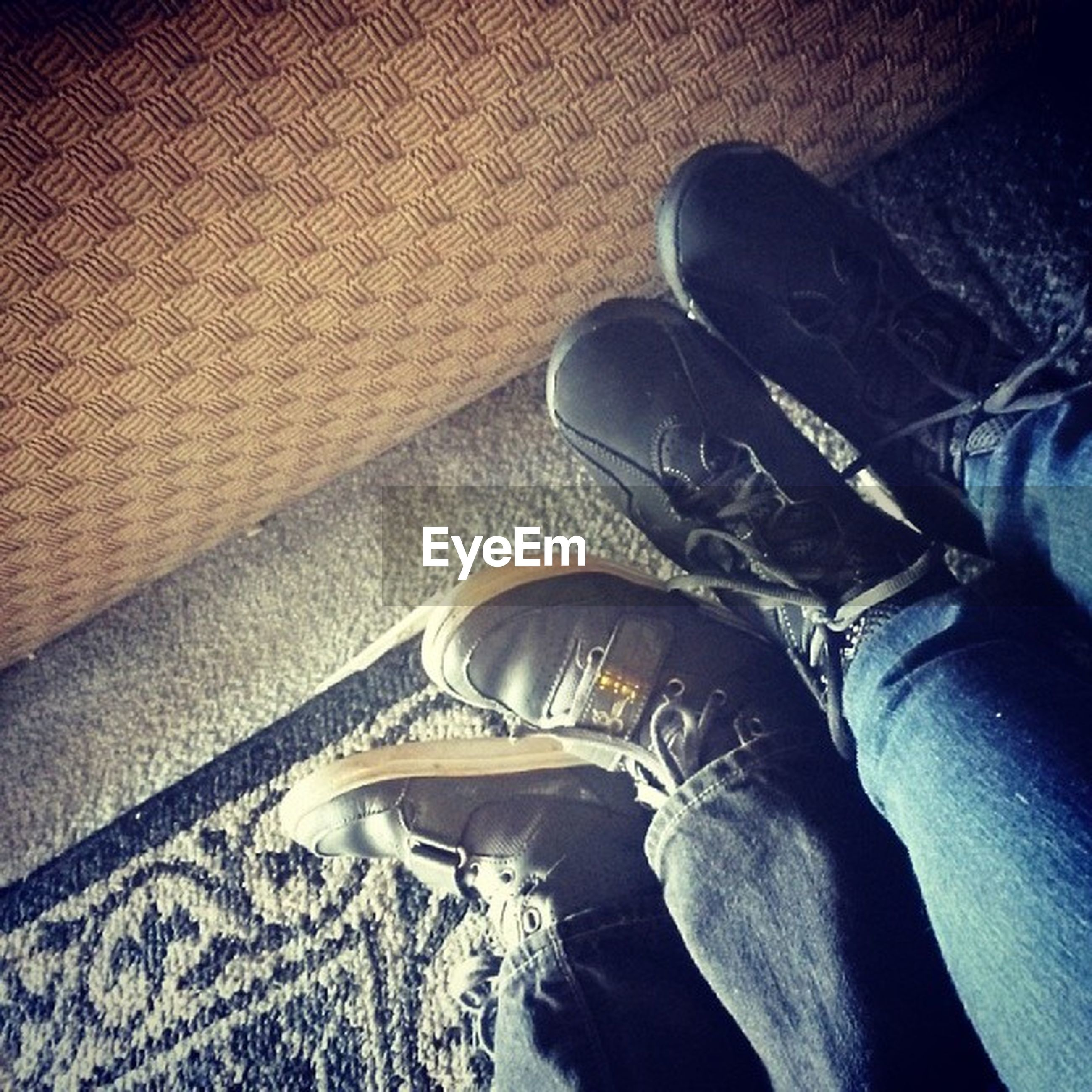 low section, person, shoe, personal perspective, indoors, jeans, high angle view, human foot, footwear, lifestyles, men, leisure activity, relaxation, unrecognizable person, part of, sitting, standing