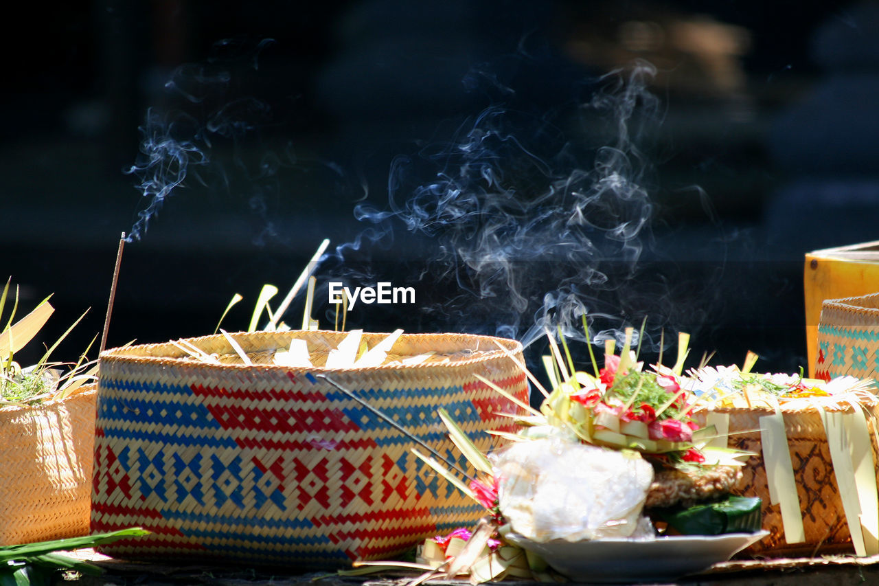 Close-up of religious offerings at temple