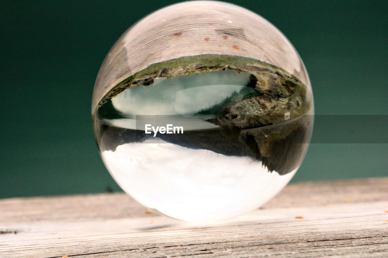 CLOSE-UP OF CRYSTAL BALL ON GLASS