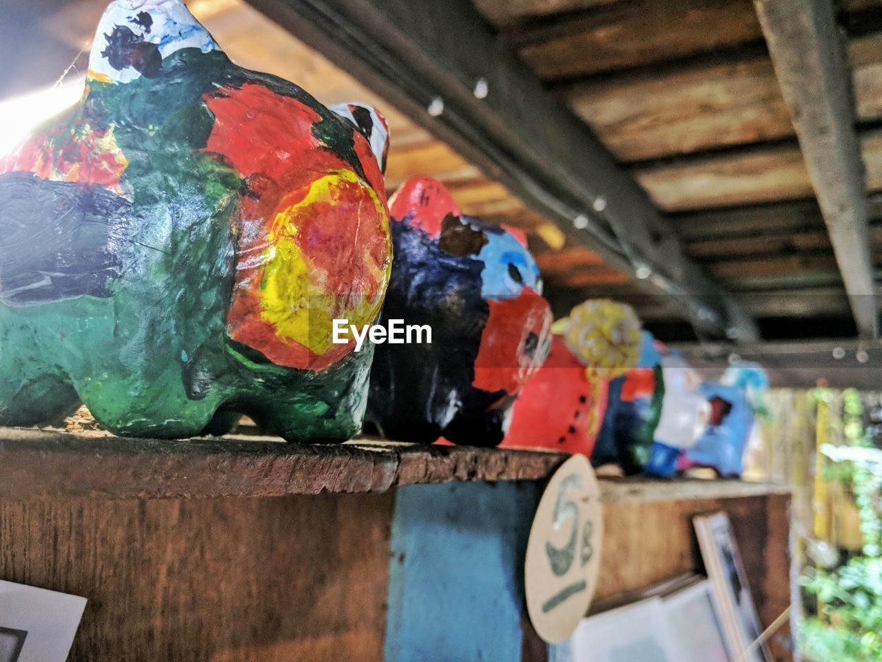 wood - material, art and craft, multi colored, no people, creativity, indoors, craft, day, close-up, focus on foreground, architecture, built structure, paint, representation, selective focus, vertebrate, wood, animal, nature, art and craft equipment